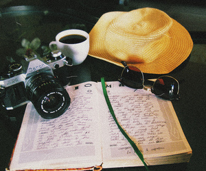 camera, book, and coffee image