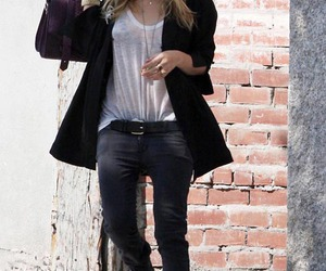 blonde, skinny jeans, and brick wall image