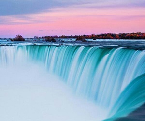 blue, pink, and waterfall image