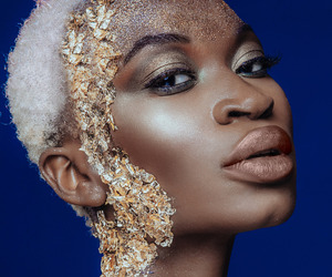 black woman, gold, and face image