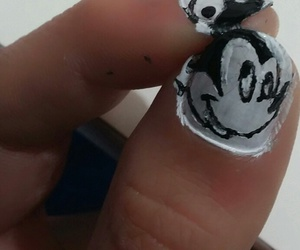 hand, mickey mouse, and mine image