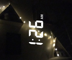 bed, fairy lights, and Late image