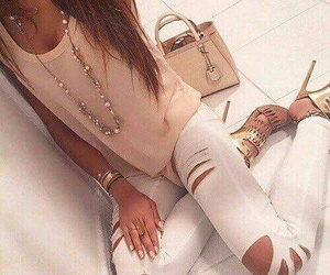 hair, white ripped jeans, and heels image