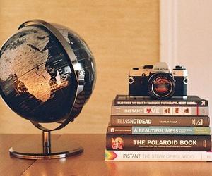 book, camera, and world image