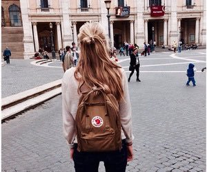 girl and backpack image