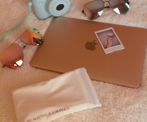 gold and polaroid laptop image
