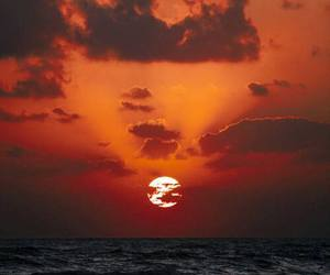 sea, sunset, and sun image
