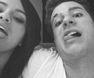 selena gomez, charlie puth, and friends image