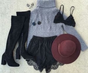 silver rings, black knee high boots, and grey turtleneck image