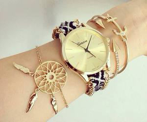 gold, bracelet, and watch image