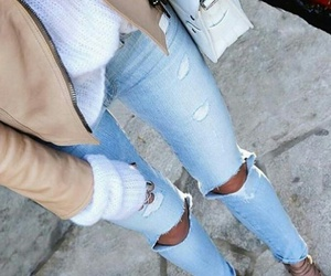 white purse, white knit sweater, and light blue ripped jeans image