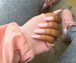 long pink nails, light blue jeans, and pink bomber jacket image