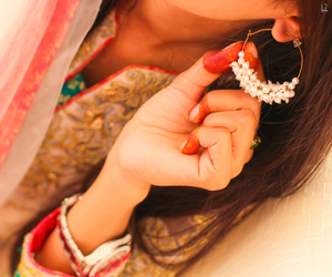 earrings, stylish, and brown hairs image