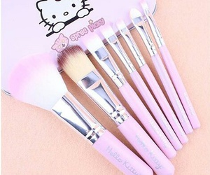 Brushes, hello kitty, and makeup image