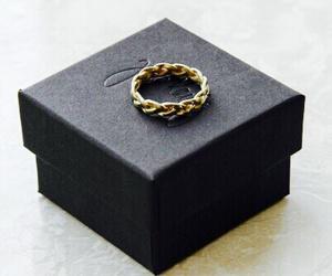 black, ring, and box image