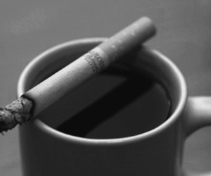 cigarettes, coffee, and match image
