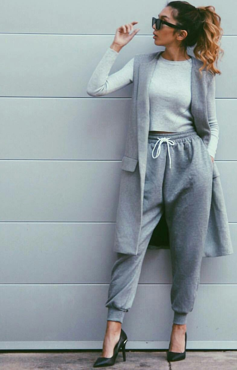 black sunglasses, grey sweater, and grey sweatpants image
