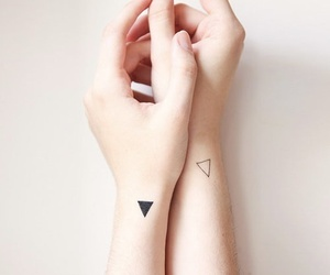 tattoo, triangle, and hands image