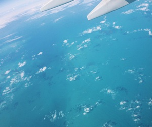 airplane, landscape, and ocean image