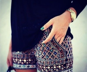 blue top and tribal designed shorts image