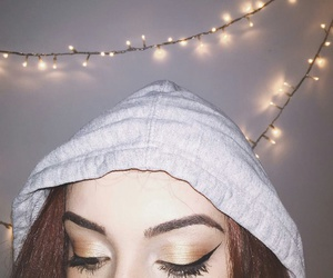 Black Eyeliner, wall lights, and grey hoodie image