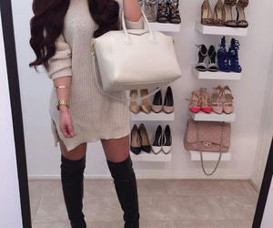 gold bracelet, black knee high boots, and gold watches image