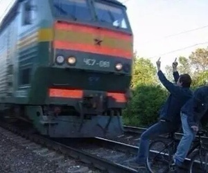train, boy, and bike image