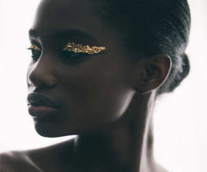 black woman, face, and gold image