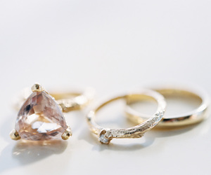 engagement ring, wedding band, and yellow gold image