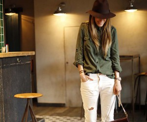 green shirt, hat, and white jeans image