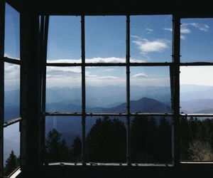 window, sky, and mountains image