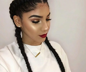 Black Eyeliner, red lipstick, and gold necklaces image