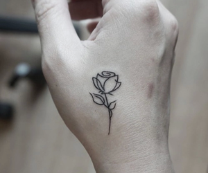 tattoo, rose, and hand image