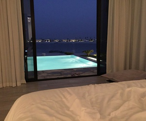 pool, luxury, and bed image