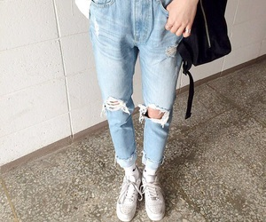 backpack, ripped jeans, and jeans image