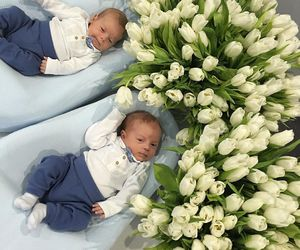 baby and flowers image