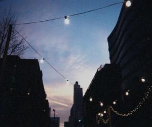 light, sky, and city image