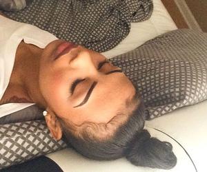 eyebrows, bun, and makeup image