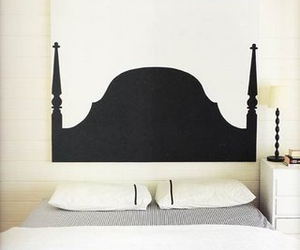 bed, headboard, and painting image
