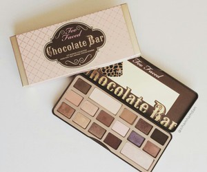 chocolate bar, too faced, and make up image