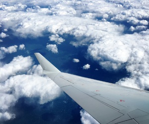 airplane, blue sky, and clouds image