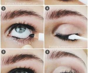 black, blue eyes, and eyebrows image