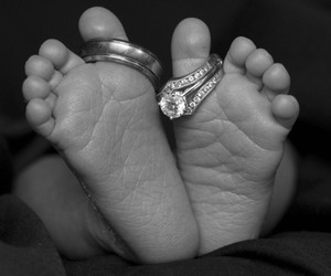 baby feet, so cute, and wedding rings image