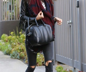 black purse, kendall jenner, and black ripped jeans image