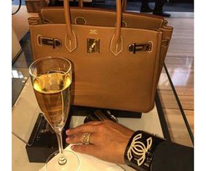 chanel, hermes, and wine image