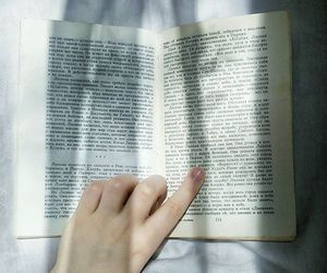 book, hand, and tumbler image