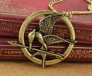the hunger games, mockingjay, and books image