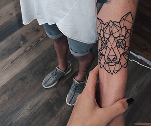 tattoo and wolf image