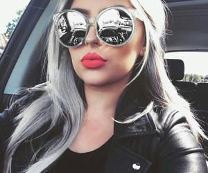 black t-shirt, red lipstick, and black leather jacket image