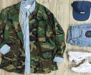military jacket, white sneakers, and light blue jeans image